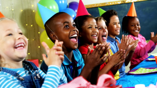 Kids clapping their hands during birthday party 4k video