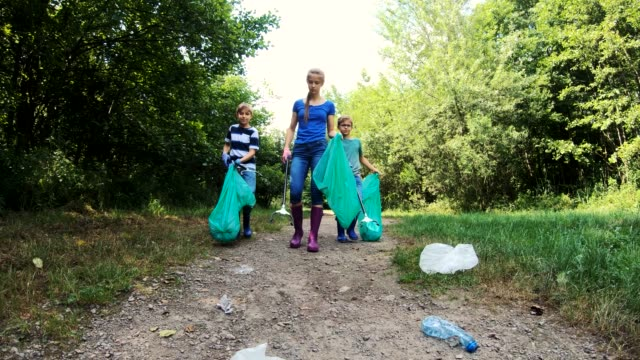 kids cleaning up the park - sustainability video stock e b–roll