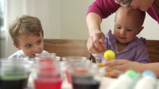Kids coloring easter eggs video