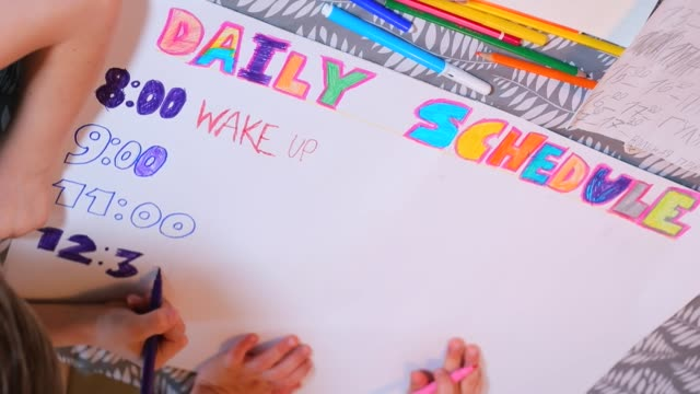 Kids create daily schedule, notes 8 a.m. wake up. Get structured, study at home. Adapt life to quarantine COVID 19. Kids homeschoolers create colorful daily schedule, notes 8 a.m. wake up. Get structured during home education and quarantine time. Adjusts to working and schooling personal organizer stock videos & royalty-free footage