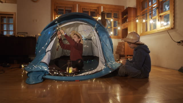 Kids decorating the tent in the living room