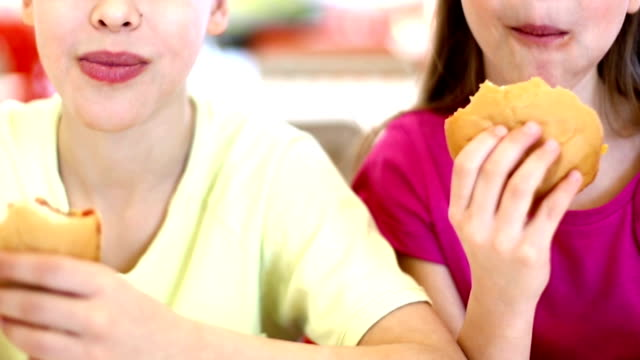 Kids eating burgers and fries. video