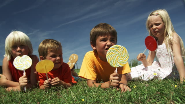 Kids eating Lollies (Shot on Red) video