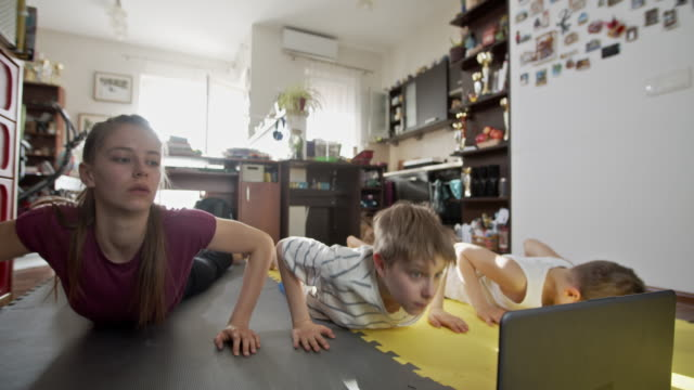 kids exercising at home during the covid-19 pandemic - strength training stock videos & royalty-free footage