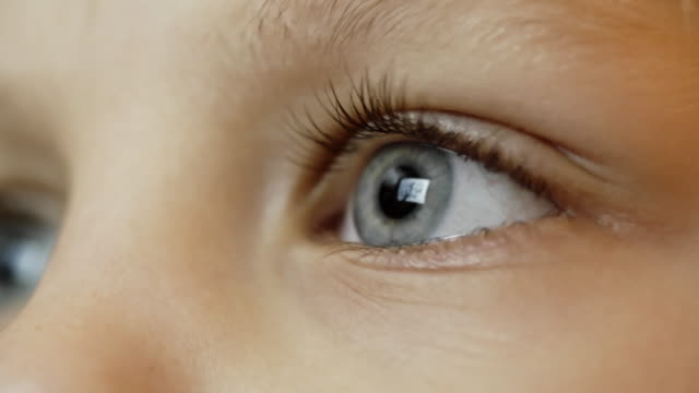 Kid's Eye Closeup of blue eye of little boy looking at digital tablet ophthalmologist stock videos & royalty-free footage