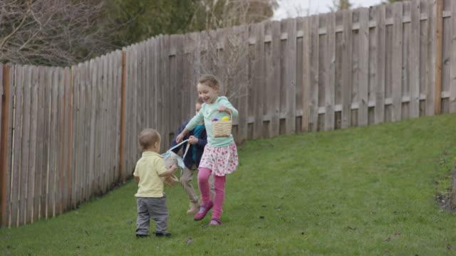 Kids having an easter egg hunt video