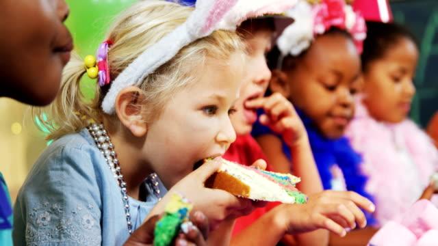 Kids having cake during birthday party 4k video