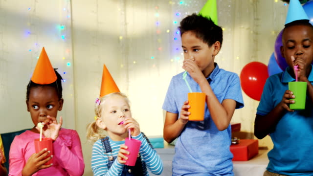 Kids having drink during birthday party 4k video