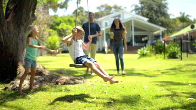 Kids having fun at the garden video