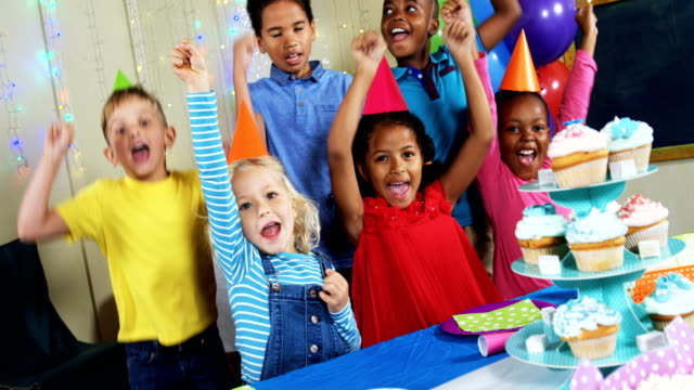 Kids having fun with each other during birthday party 4k video