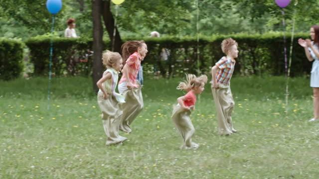 Kids Jumping in Sacks video