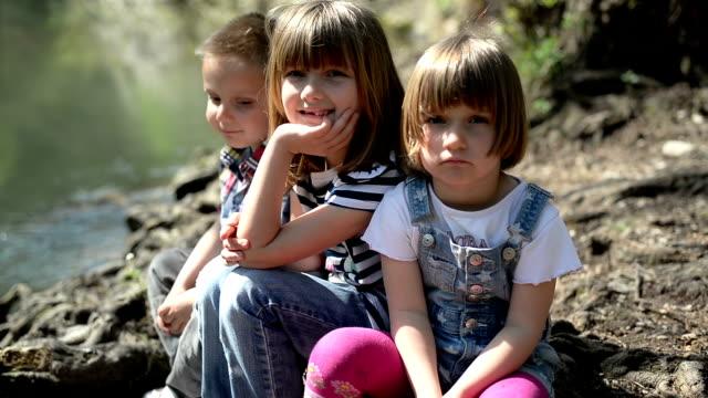 Kids looking at camera video