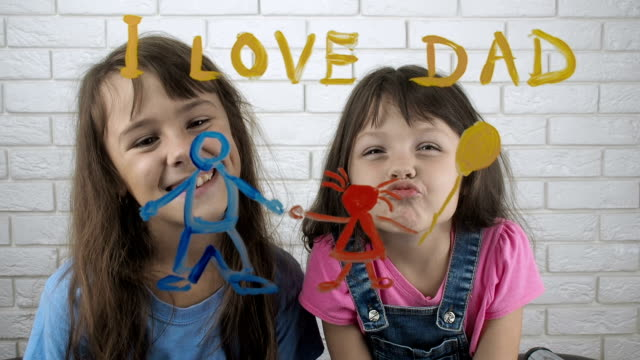 Kids love father. Kids love father. Daughters give dad a gift. charming stock videos & royalty-free footage