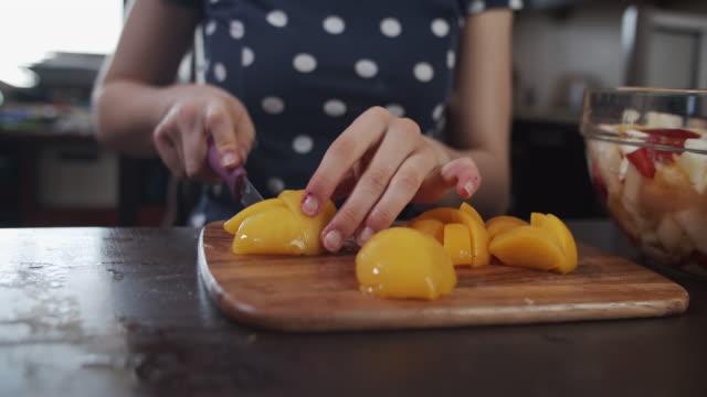 kids making fruit salad at home. - pesche bambino video stock e b–roll