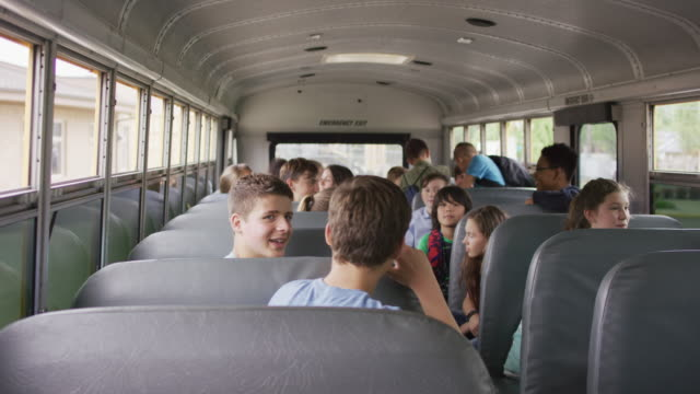kids on a school bus - middle school stock videos & royalty-free footage