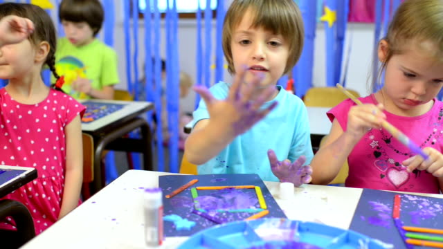kids painting at kindergarten - kindergarten стоковые видео и кадры b-roll