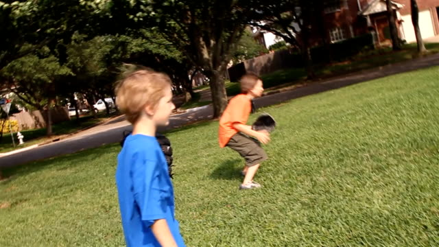 Kids Playing Ball With Their Father video