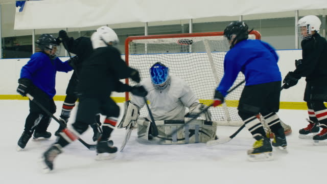 Kids playing ice hockey professionally Fight for the puck near goal post in kid ice hockey match goal post stock videos & royalty-free footage