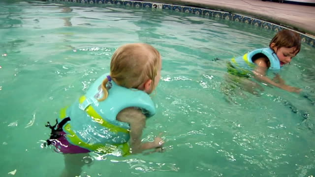 Kids Playing In Pool video