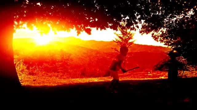 Kids playing, mountain range sunset video