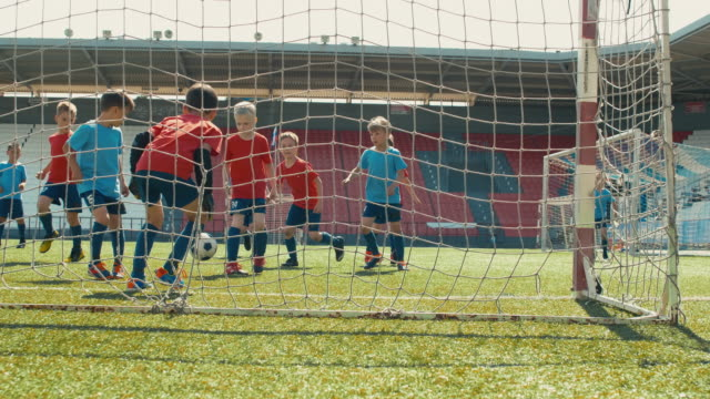 Kids playing professional soccer on stadium Boys playing soccer, getting long pass, attacking goal post and making goal goal post stock videos & royalty-free footage