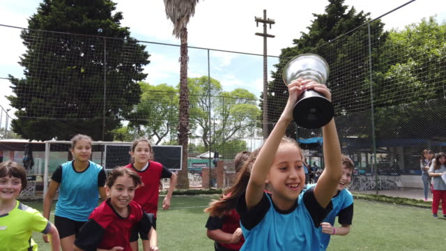 kids playing soccer - boys and girls on a football court in training - championship stock videos & royalty-free footage