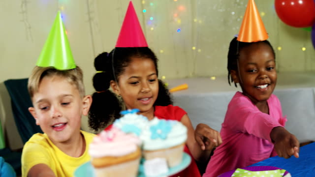 Kids pointing at sweet foods during birthday party 4k video