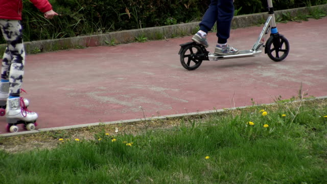 VARNA, BULGARIA - APR 26, 2017 - Kids riding scooters and roller skates VARNA, BULGARIA - APR 26, 2017 - Kids riding scooters and roller skates skink stock videos & royalty-free footage