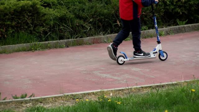 VARNA, BULGARIA - APR 26, 2017 - Kids riding scooters Kids riding scootersVARNA, BULGARIA - APR 26, 2017 - Kids riding scooters skink stock videos & royalty-free footage