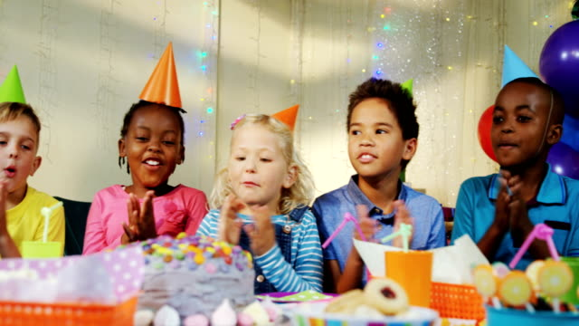 Kids singing birthday songs during birthday party 4k video
