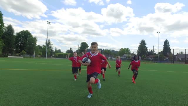 Kids soccer team celebrating after soccer match video