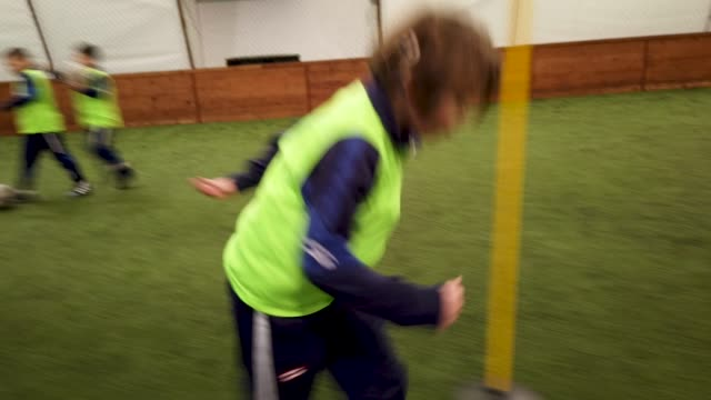 Kid's Soccer Training Group of children on soccer training. implant stock videos & royalty-free footage