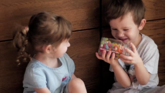 kids trying to open jar of candies kids trying to open jar of candies jar stock videos & royalty-free footage
