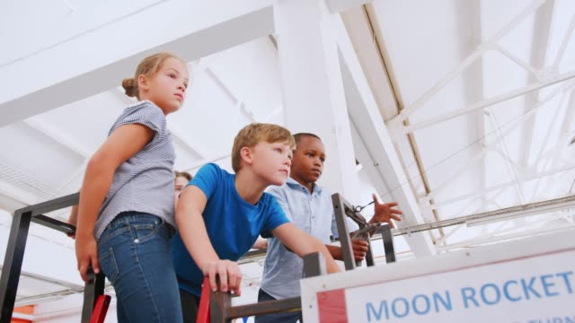 Kids using an air pressure rocket at science activity centre Kids using an air pressure rocket at science activity centre exhibition stock videos & royalty-free footage