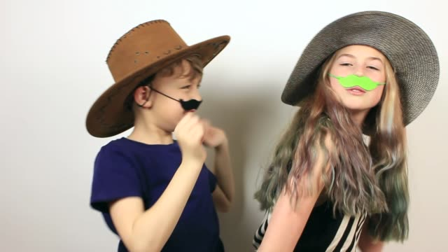 kids with hats and fake moustaches are having fun. - april fools day stock videos and b-roll footage