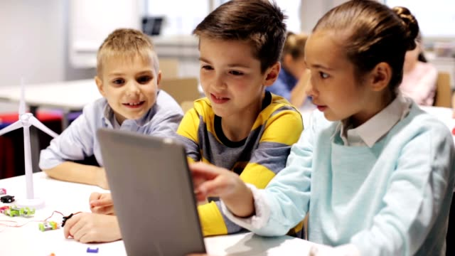 kids with tablet pc programming at robotics school video