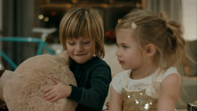 Kids with Teddy bears on christmas eve video