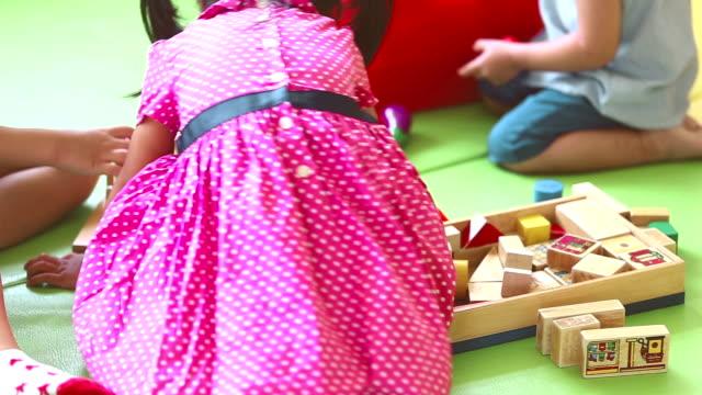 Kindergarten, kids playing with blocks toy video