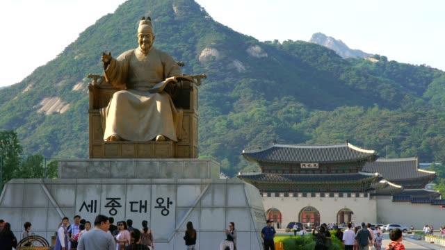 King Sejong Statue in Gwanghwamun Plaza with Gwanghwamun Gate in background FS7 gyeongbokgung stock videos & royalty-free footage