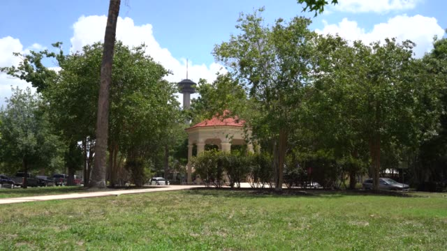 king william park gazebo with tower in background - san antonio texas stock videos & royalty-free footage
