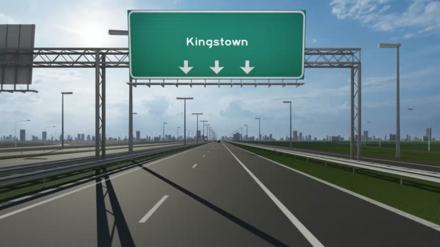 kingstown city signboard on the highway conceptual stock video indicating the entrance to city - kingstown video stock e b–roll
