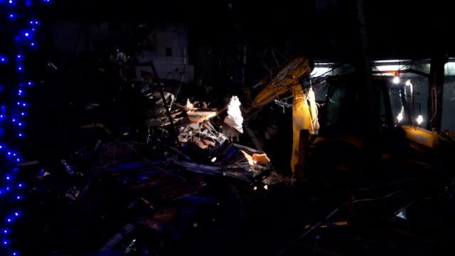 Kiosk demolition at night