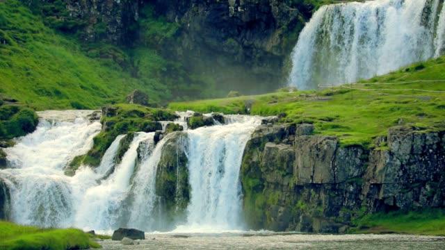 kirkjufellsfoss waterfall in iceland, slow motion - fiordo video stock e b–roll