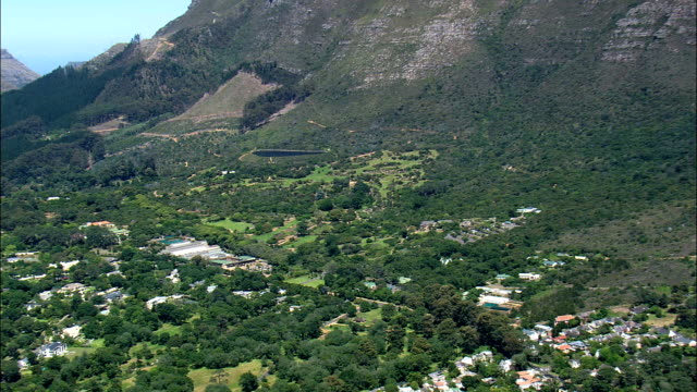 Kirstenbosch National Botanical Garden  - Aerial View - Western Cape,  South Africa This clip was filmed by Skyworks on HDCAM SR 4:4:4 using the Cineflex gimbal. Western Cape,   South Africa table mountain national park stock videos & royalty-free footage