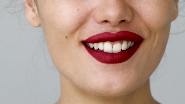kissing sending, close-up shoot of female mouth kissing sending - collagene video stock e b–roll