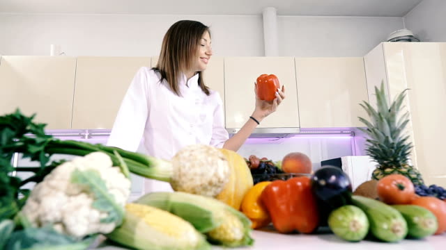 Kitchen and food. A woman holds pepper in her hands. Kitchen and food. A woman holds pepper in her hands. nutritionist stock videos & royalty-free footage