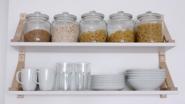 kitchen cupboard shelves are filling with crockery - stop motion - comparsa video stock e b–roll