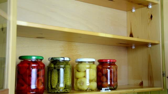 kitchen jar vegetable woman neatly align various pickles vegetable jars kitchen wooden shelf cabinet stock videos & royalty-free footage