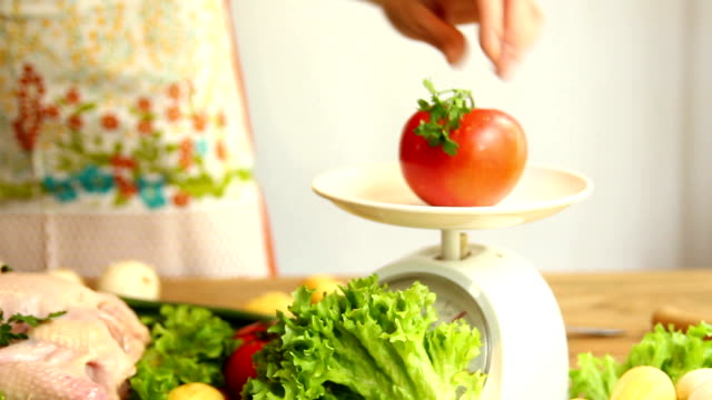 kitchen scales and fresh vegetables