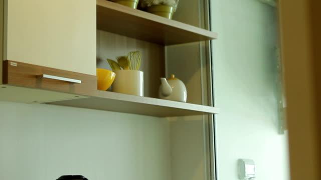 kitchen - looking inside inside cabinet bildbanksvideor och videomaterial från bakom kulisserna